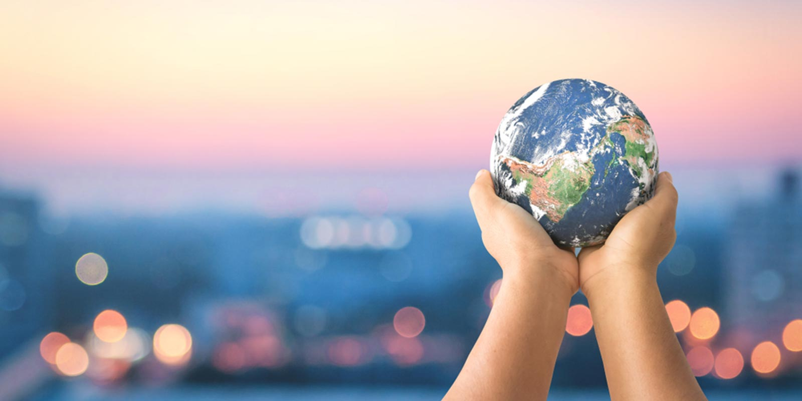Hands holding earth globe sharing your gifts