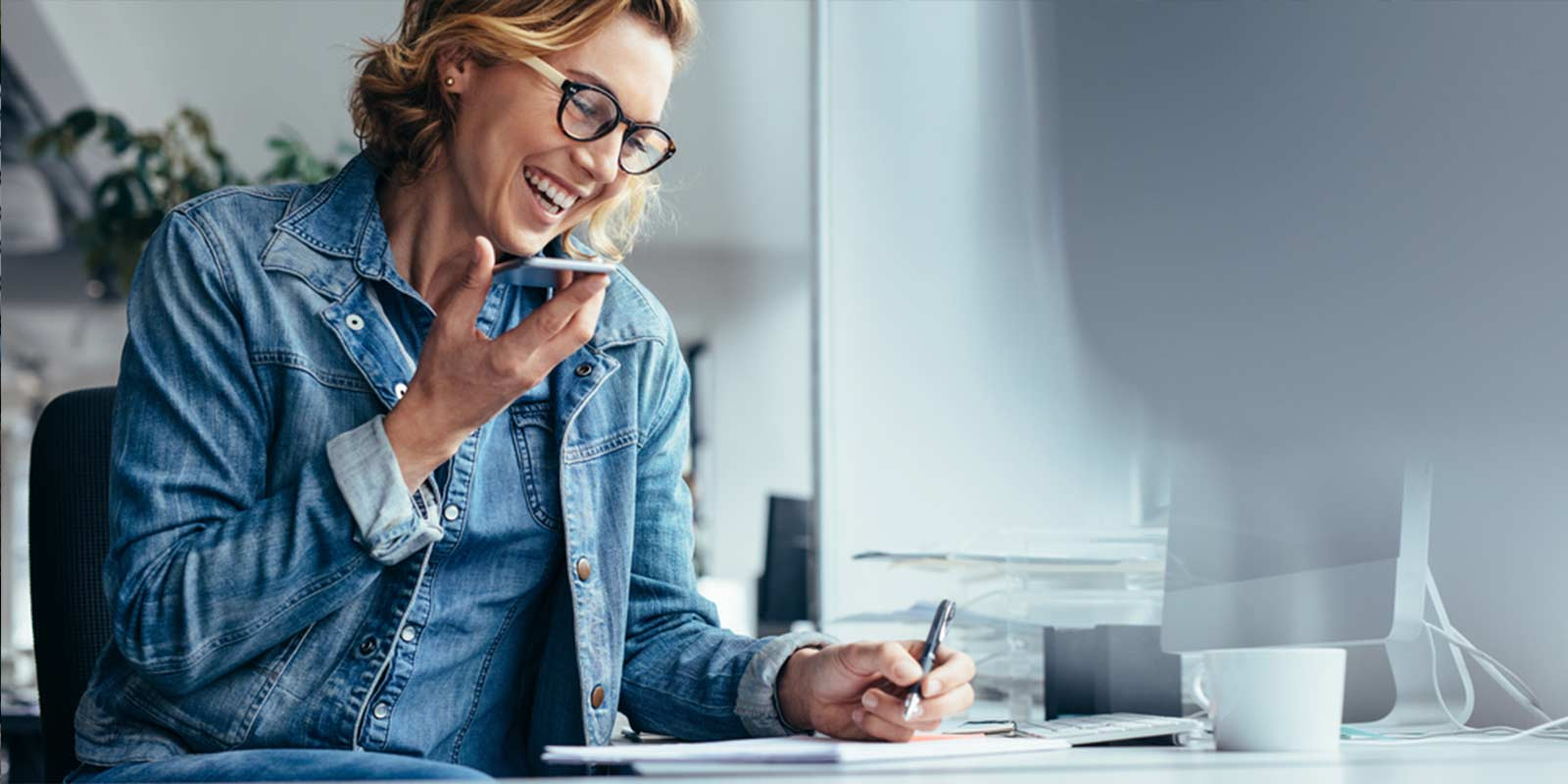 Business woman smiling as she reflects on how to get more clients.
